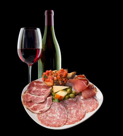 antipasto platter: Italian antipasto and wine