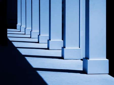 recedes: Columns in blue Stock Photo