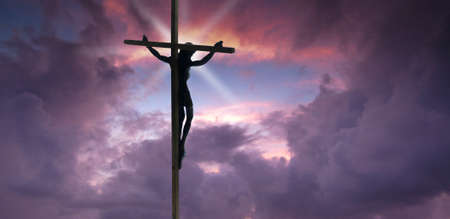 christian background: Jesus Christ on the Cross with sunset clouds Stock Photo