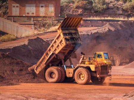 dump truck: Dump truck at bauxite quarry Stock Photo