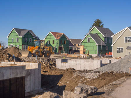 A single family home under construction in a housing development complex.