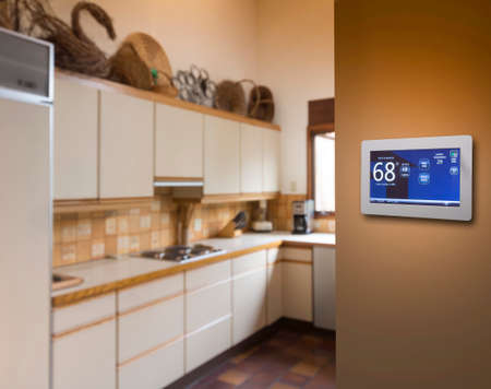 programmable: Programmable thermostat for temperature control in kitchen