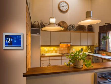 Programmeerbare thermostaat voor temperatuurregeling in keuken Stockfoto - 35008923