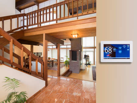 heat home: Programmable thermostat for temperature control in entrance
