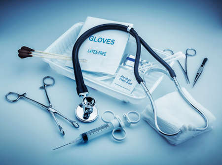 otorhinolaryngology: Medical instruments for ENT doctor on pale blue