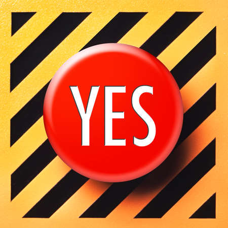 yes button: Yes button in red on a yellow and black background Stock Photo