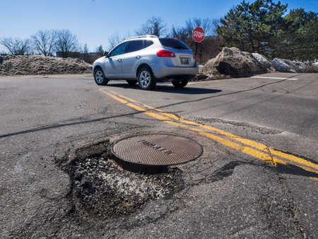 pot hole: Big pothole caused by freezing and thawing during spring season