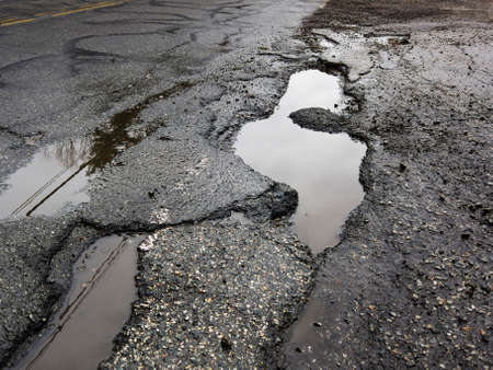 Big pothole caused by freezing and thawing during spring season