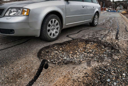 Big pothole in road Stock Photo