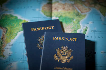 Passports on a map of the world with limited depth of field photo