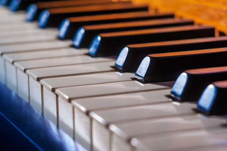 hymnal: Close-up of piano keys in blues and orange