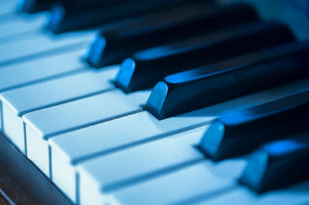 jazz: Close-up of piano keys in blues as a concept for jazz