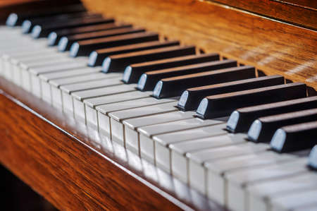 keyboard instrument: Close up of piano keyboard with limited depth of field