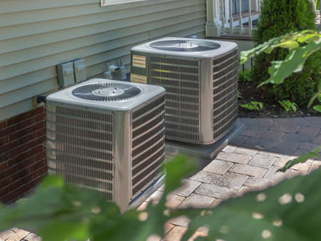 HVAC heating and air conditioning residential units or heat pumps Archivio Fotografico