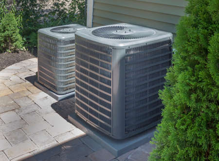 HVAC heating and air conditioning residential units or heat pumps 스톡 콘텐츠
