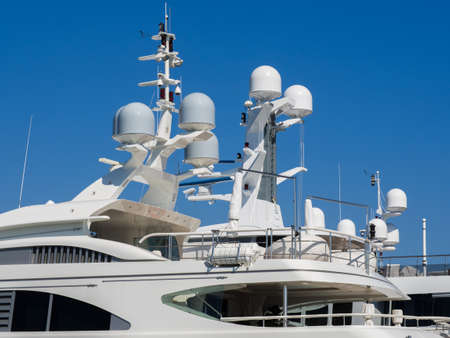 transmitter: Navigation system antennas of big white motor yacht