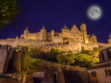 Carcassonne fortress in southern France with moon