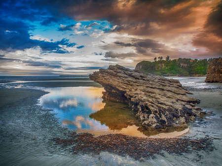 Rock formation in tidal pool in New Zealand