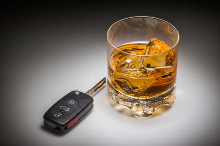 Drinking and driving concept with whiskey and car keys