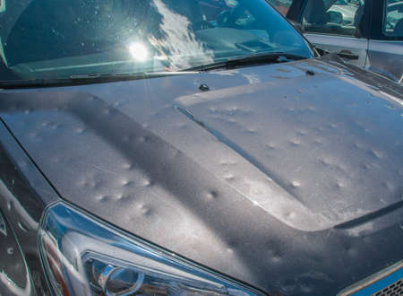 Hail damage to a car during a big storm