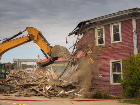 A digger demolishing a house for reconstruction. Stock fotó