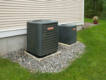 Heating and air conditioning units in back of an apartment complex Stok Fotoğraf