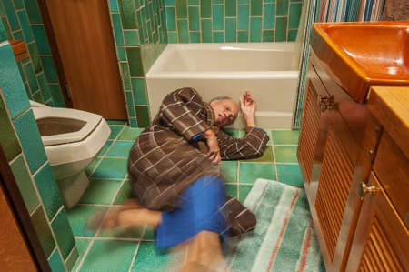Senior man falling in a bathroom Stock Photo