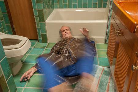 Senior man falling in a bathroom Stock Photo