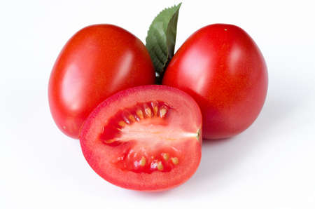 red plum tomatoes on white isolated background