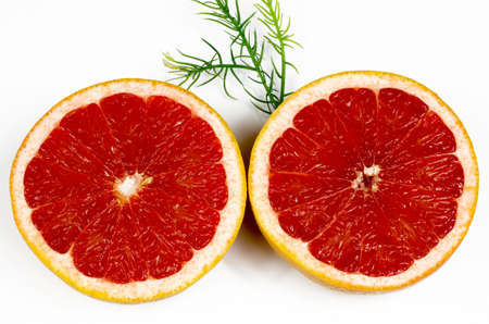 two halves of grapefruit shown inside of a fruit isolated on white