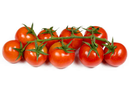 red ripe tomatoes combined in a green beam lie on a white table Imagens