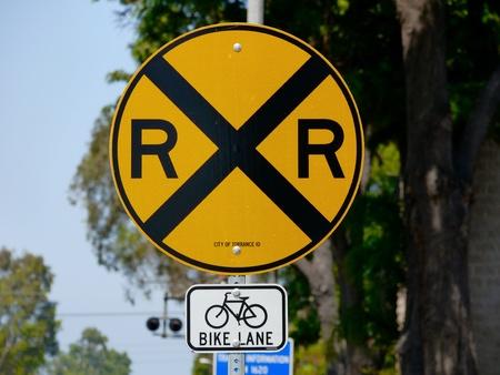 rail cross: Yellow Railroad crossing sign