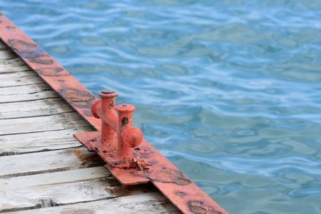 Old pier and blue water in summer Stock Photo