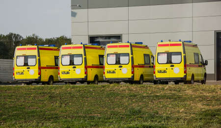 New yellow ambulances in the parking lot. clear day Stock Photo
