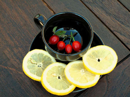 a cup of tea with lemon fruit hip photo