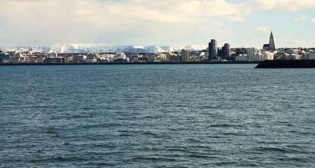 scandinavian peninsula: View of the city of Reykjav�k ships sailing on the sea