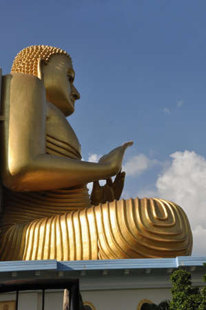 big golden buddha in dambulla, sri lanka, photo