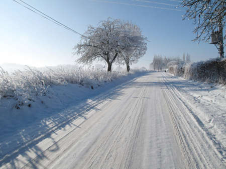 fairplay: Road covered in snow in a winter landscape Stock Photo