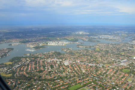Airplane view of the city of Sydney Australia Stock Photo