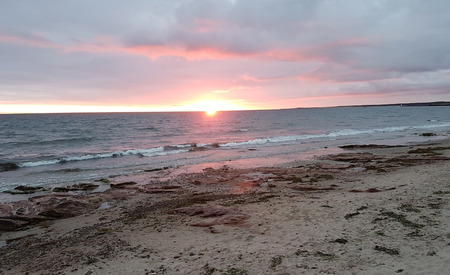 beautiful sunrise on the beach of Nairn. Nairn is a city in the Scottish Council Area Highland. It is located on the south bank of the Moray Firth about 26 km east-northeast of Inverness and 35 km west of Elgin. Stock Photo