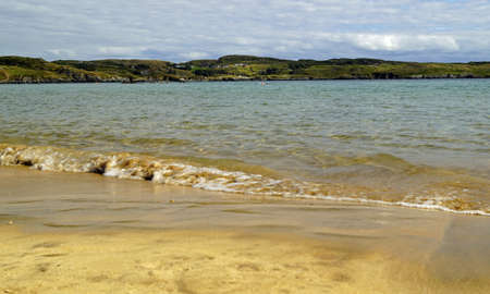 Fintra beach is a beautiful sandy beach just a couple of kilometers outside the fishing port of Killybegs. 版權商用圖片