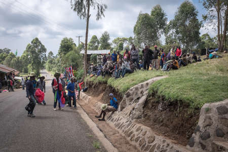 guides: Machame, KilimanjaroTanzania - January 16, 2016: Porters and guides meeting before climbing Kilimanjaro near Machame gate in KilimanjaroTanzania on January 16, 2016