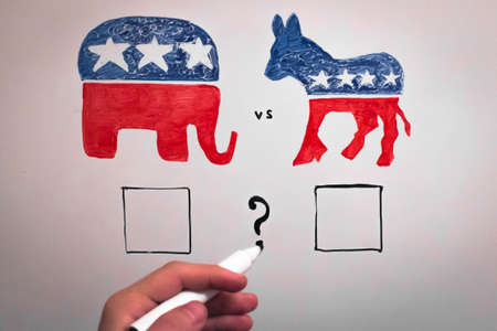 concurrent: Concurrent politics concept. Democrats vs republicans elections. USA 2016. Drawn on whiteboard with markers. Empty squares voting and hand with marker.
