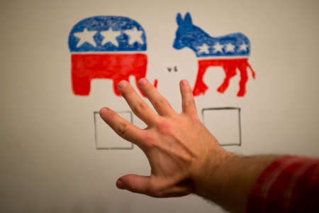 Concurrent politics stop concept. Democrats vs republicans elections. USA 2016. Drawn on whiteboard with markers. Hand