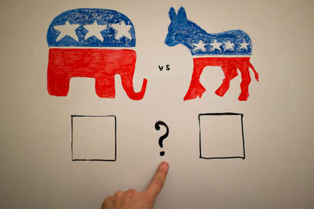 concurrent: Concurrent politics concept. Democrats vs republicans elections. USA 2016. Drawn on whiteboard with markers. Finger as pointer, question who win.