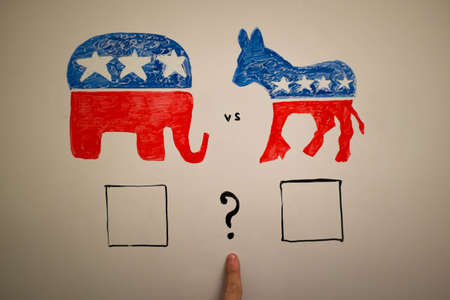 Concurrent politics concept. Democrats vs republicans elections. USA 2016. Drawn on whiteboard with markers. Finger as pointer, question who win.