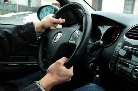 swerve: young man whos driving, steering wheel Stock Photo