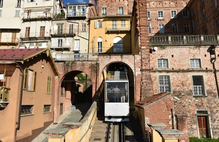 Panorama of medieval buildings with funicular of Mondovi Piazza Imagens
