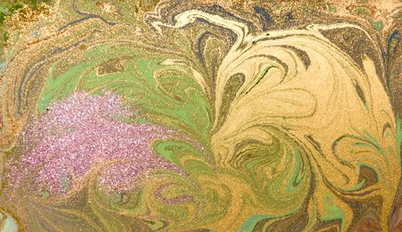 marbled effect: Green, purple and golden liquid texture. Hand drawn marbling background. Ink marble abstract pattern Stock Photo