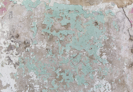 beton: Old painted wall. Green and damage surface. Peeling paint background. Stone demaged backdrop.